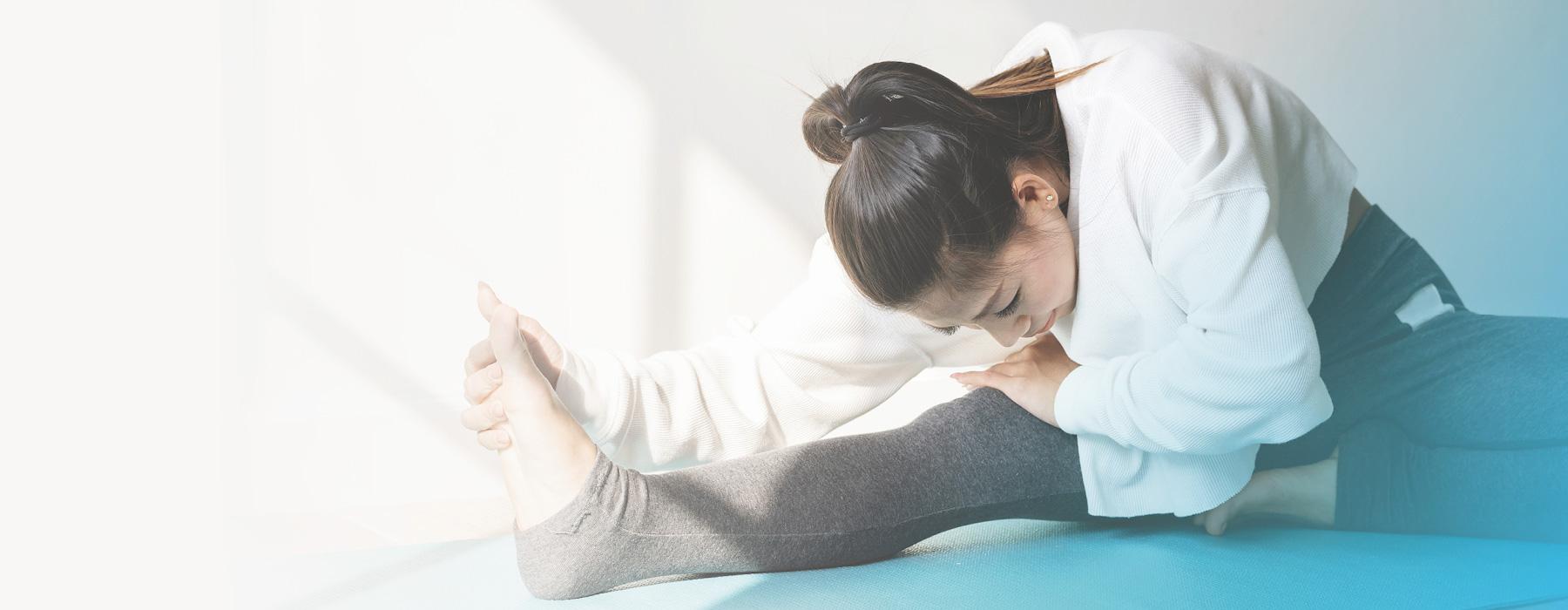 Woman stretching in yoga studio.