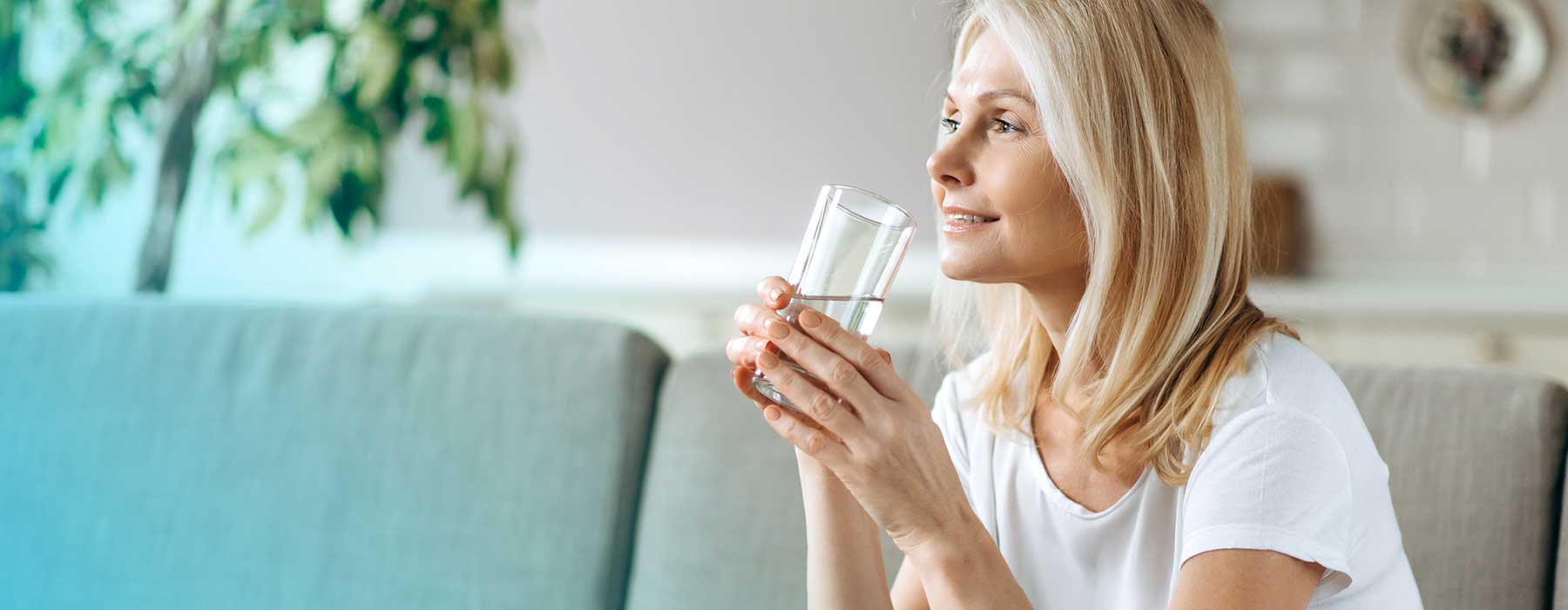 Woman drinking water with Skybright Concentrated Mineral Drops added.