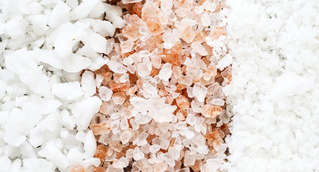 Closeup image of unrefined, unprocessed sea salt. A better option than table salt.