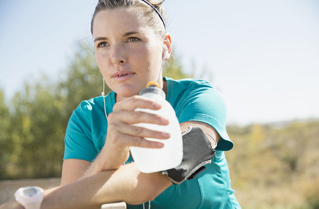 Woman drinking Skybright Performance Electrolytes from water bottle