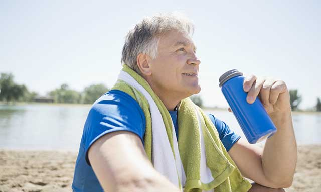 Man drinking Skybright Performance Electrolytes from water bottle.